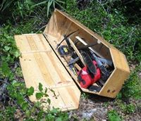 Nunchucks, sickles among large cache of weapons found in coffin