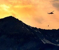 Firefighters try to stop wildfire from reaching Colo. homes