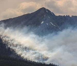 In this July 5, 2017, file photo, a wildfire burns near Breckenridge, Colo. (Photo/AP)