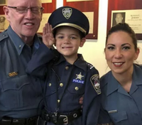 Colo. city's 'youngest officer' celebrates end of chemo with family, fellow cops