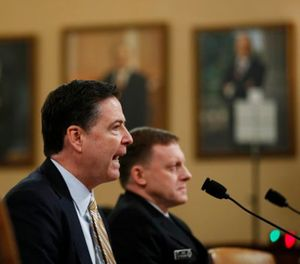 FBI Director James Comey, left, accompanied by National Security Agency Director Michael Rogers testifies on Capitol Hill in Washington, Monday, March 20, 2017, before the House Intelligence hearing on allegations of Russian interference in the 2016 U.S. presidential election. (AP Photo/Manuel Balce Ceneta)