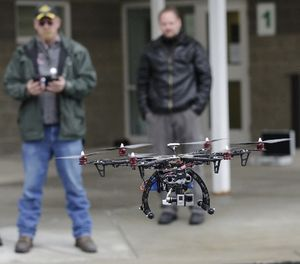 In this Feb. 13, 2014, photo, members of the Box Elder County Sheriff's Office search and rescue team fly their search and rescue drone during a demonstration, in Brigham City, Utah. (AP Photo/Rick Bowmer)