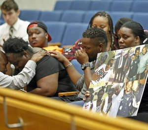 Matrice Stanley, at left in black, sister of Donnell Thompson, 27, who was fatally shot by Los Angeles County Sheriff's deputies in Compton, Calif., and other family members appear before Los Angeles County supervisors at the County Hall of Administration in downtown Los Angeles Tuesday, Aug. 9, 2016. (AP Photo/Nick Ut)