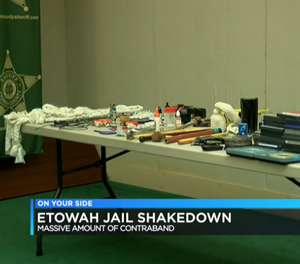 There was a table full of items — improvised weapons, ropes, DVDS among them — on display at a press conference Friday. (Photo/Screenshot via WBRC)