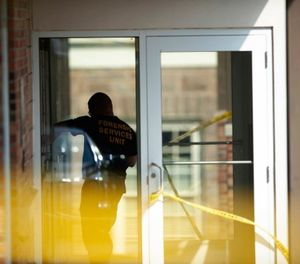 An officer investigates a shooting that occurred in the Masontown borough municipal center on Wednesday, September 19, 2018, in Masontown, Pa. (Andrew Stein/Post-Gazette via AP)