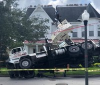 Photos: Firefighters respond after crane falls into home
