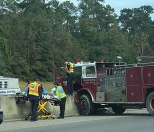 vintage fire truck crashed on Interstate 10 on Monday, coming to rest against a concrete wall on the Tchoutacabouffa River Bridge, police say. (Photo/Harrison County Police)