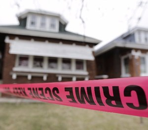 Crime scene tape surrounds a home Friday, Feb. 5, 2016, in Chicago. (AP Photo/M. Spencer Green)