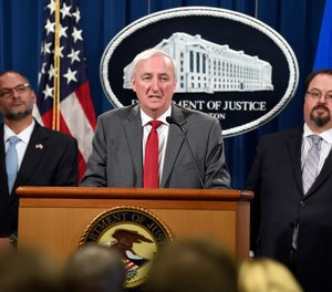 Deputy Attorney General Jeffrey Rosen, center, flanked by Hugh Hurwitz, left, the acting director of the Bureau of Prisons, and David Muhlhausen, director of the National Institute of Justice, speaks during a news conference at the Justice Department in Washington, Friday, July 19, 2019, on developments in the implementation of the First Step Act. (AP Photo/Susan Walsh)