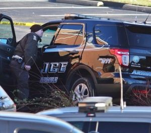Arnold Police investigate the scene of a shooting of one of their own officers on Tuesday, Dec. 5, 2017, in the parking lot of the Arnold Police Station in Arnold, Mo. (J.B. Forbes/St. Louis Post-Dispatch via AP)