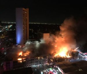 A fire burns in a four-story condominium building in Dallas, early Saturday, March 4, 2017.  (AP Photo/Mary Clare Jalonick)
