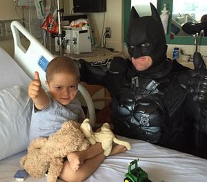 Officer Damon Cole hangs out with 4-year-old Max Brown, who is undergoing treatment for acute lymphoblastic leukemia. (Photo/Emily Brown)