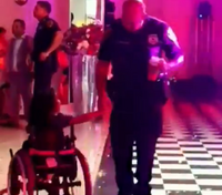 Video: Officer dances with young girl in wheelchair at party
