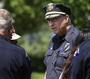 Aurora Police Chief Dan Oates talks to guests at the funeral for Aurora, Colo., movie theater shooting victim AJ Boik, Friday, July 27, 2012. (AP Image)