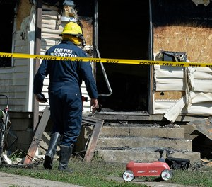 The initial investigation by Erie fire officials found that there was only one smoke alarm in the two-story residential structure, and it was in the attic.  (Photo/AP)
