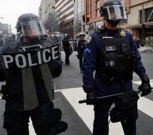 Police stand on K street as protesters try to disrupt the inauguration of President Donald Trump on Jan. 20, 2017 in Washington, D.C. (Photo/Olivier Douliery/Abaca Press/TNS)