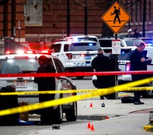 In this Nov. 28, 2016, file photo, crime scene investigators collect evidence from the pavement as police respond to an attack on the Ohio State University campus in Columbus, Ohio. (AP Photo/John Minchillo, File)