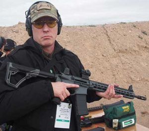 P1 Editor in Chief Doug Wyllie shoots the Daniel Defense M4 Carbine V11 SLW at SHOT Show 2016. (PoliceOne Image)