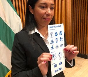 Sgt. Andrea Cruz holds a card that is being sent to nearly 12,000 deaf and hard of hearing motorists. (AP Photo/Michael R. Sisak)