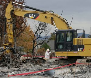 Private contractors working 12-hour days, seven days a week swarmed the debris-strewn lots. (Photo/AP)
