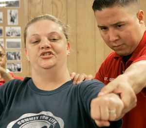 Texas Department of Criminal Justice Sgt. Louis Garcia, right, works with corrections officer trainee Christy Lawson on her jabs during a training session at the Minnie Houston Training Center in Riverside, Texas, Thursday, May 3, 2007. (AP Photo/Pat Sullivan)