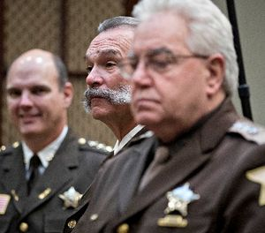 Richard Stanek, sheriff from Hennepin County, Minnesota, from left, Danny Glick, sheriff from Laramie County, Wyoming, and John Layton, sheriff from Marion County, Indiana, stand before the start of a listening session with U.S. President Donald Trump, not pictured, in the Roosevelt Room of the White House on Feb. 7, 2017 in Washington, D.C. (Andrew Harrer/Pool/Abaca Press/TNS)
