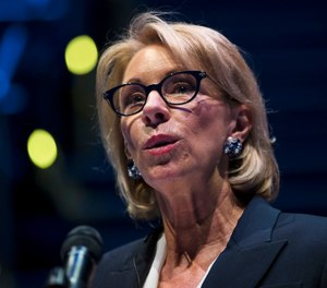President Donald Trump's school safety commission is proposing a rollback of Obama-era guidance that was meant to curb racial disparities in school discipline. The commission was led by Education Secretary Betsy DeVos and made dozens of policy recommendations in a report released Tuesday. Trump created the panel in March following the deadly school shooting in Parkland, Florida. (AP Photo/Matt Rourke)