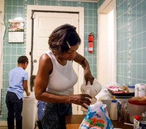 In this Tuesday, Dec. 6, 2016 file photo, Delores Anderson takes care of her three granddaughters at home in the Englewood neighborhood in Chicago. (Brian Cassella/Chicago Tribune via AP, File)