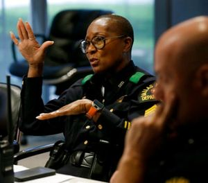 In this June 22, 2017, photo, Dallas police Sgt. Bridget Wilson-Jones adds to a discussion related to a task during a training session at the Center for Brain Health in Dallas. (AP Photo/Tony Gutierrez)