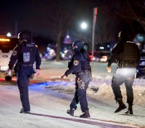 Detroit police officers are at the scene of a barricaded gunman situation Monday, Feb. 12, 2018 in Detroit. Two women were fatally shot and a police officer and another person wounded. (David Guralnick/Detroit News via AP) (David Guralnick/Detroit News via AP)