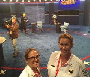 Sabina Braithwaite, MD Deputy Chief of Washington University EMS, and Maia Dorsett, MD 2016 Fellow in EMS Medicine, in the debate hall. (Photo courtesy of Dr. David K. Tan)