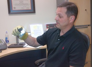Greg Price, S&T's First Responders Group program manager, demonstrates the new glove. (Image DHS Science and Technology Directorate)