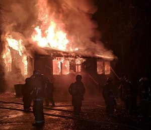 Dispatcher Barbara Hughes was working when she took a 911 call reporting a blaze in the area where she lives. (Photo/City of Suffolk)