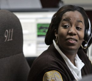 Brunswick County Dispatcher and Chief of Communications Joy Seward, man's the desk in her office in Lawrenceville, Va., Thursday, Jan. 29, 2009. (AP Photo/Steve Helber)