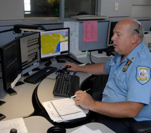 This July 14, 2009 photo shows senior dispatcher Ken Marks working at the Albany Police Department call center in Albany, N.Y. (AP Photo/Tim Roske)