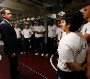 In this Wednesday, June 17, 2015, Jersey City Mayor Steven Fulop, left, talks to police department officers during a training session in Jersey City, N.J. (AP Photo/Julio Cortez)