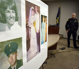 Photos of Linda and Clifford Bernhardt, who were killed in 1973, are displayed at a press conference at the Yellowstone County administrative offices in Billings, Montana on Monday, March 25, 2019. (AP Photo/Matthew Brown)
