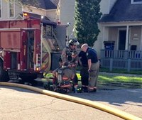 Firefighters perform CPR, save dog at house fire