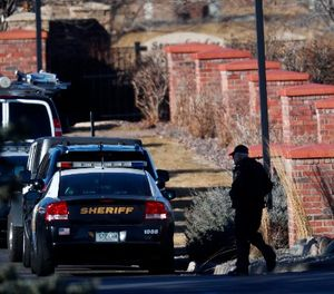 An investigator heads to the scene of a deadly domestic disturbance Sunday, Dec. 31, 2017, in Highlands Ranch, Colo. (AP Photo/David Zalubowski)