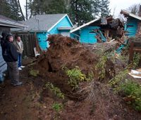 Woman killed by tree as storms drench Pacific Northwest