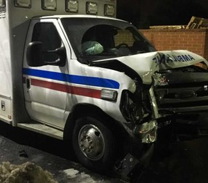 The patient hit two police vehicles with the ambulance before crashing into a tree. (Photo/YouTube)