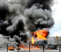 Video: Man jumps from fuel tanker as it explodes into flames