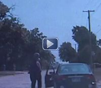 Video: Mich. cop attacked, dragged before shooting suspect in pursuit