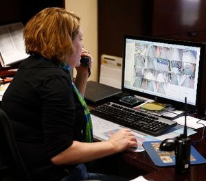"""In this May 6, 2016, photo, Forest Dale Elementary School administrative assistant Heather Fellabaum tracks an """"intruder"""" and announces their whereabouts via the schools public address system as the school holds a intruder drill in Carmel, Ind. (AP Photo/Michael Conroy)"""