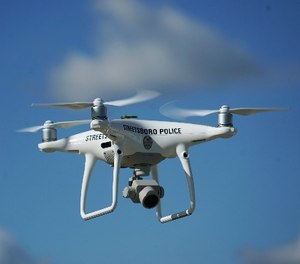 In this Oct. 16, 2017 photo, the Streetsboro police department's first drone flies in Streetsboro, Ohio. (AP Photo/Dake Kang)