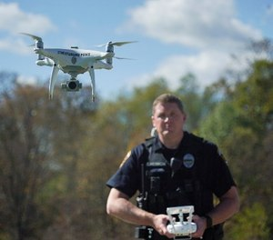 In this Oct. 16, 2017 photo, Streetsboro Officer Scott Hermon pilots the department's first drone in Streetsboro, Ohio. (AP Photo/Dake Kang)