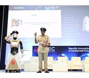 A police spokesperson shows off the new robot officer. (Photo/Dubai police)