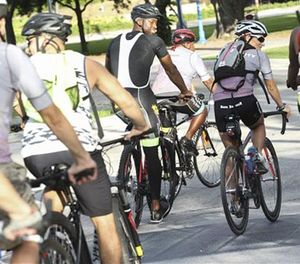 Chicago Bulls' Dwyane Wade, center left, rides with a group of cyclists in the D.Wade Community Bike Ride at Regatta Park in Miami, Saturday, Sept. 17, 2016. (AP Photo/Miami Herald)