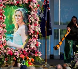 In this Aug. 11, 2017, file photo, Johanna Morrow plays the didgeridoo during a memorial service for Justine Damond in Minneapolis. (Aaron Lavinsky/Star Tribune via AP, File)