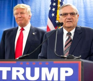 In this Jan. 26, 2016, file photo, then-Republican presidential candidate Donald Trump is joined by Joe Arpaio, the then sheriff of metro Phoenix, during a news conference in Marshalltown, Iowa. (AP Photo/Mary Altaffer, File)